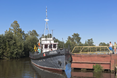 work boat: Corporate work boat Swan at the pier in the city of Belozersk Vologda region, Russia