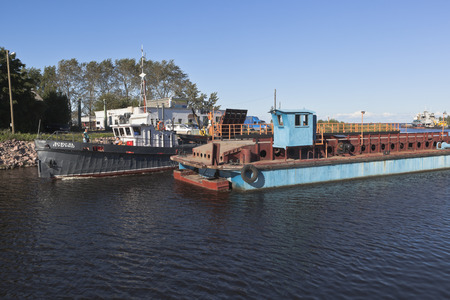 work boat: Corporate work boat Swan passes through the bridge divorced Ilinskiy on Belozersky bypass canal in the city of Belozersk Vologda region, Russia Editorial
