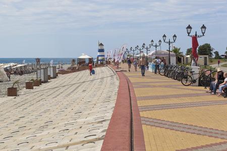 krasnodar region: People walk along the promenade near the Sochi Olympic Park, Adler, Krasnodar region, Russia