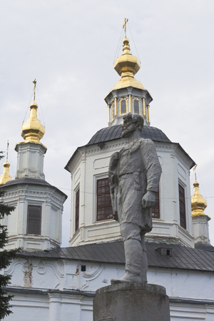 Monument to Semyon Ivanovich Dezhnev against the background of the domes of the Cathedral of the Assumption of the Blessed Virgin Mary in Veliky Ustyug, Vologda region, Russia