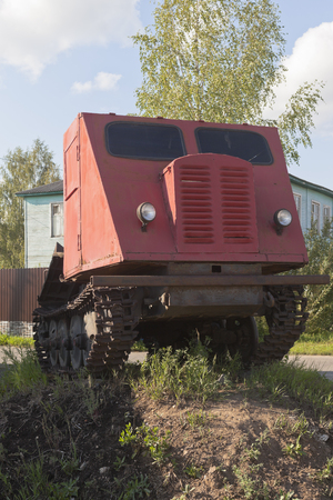 skidding: Skidder tractor TDT-40 installed as a monument on the earthen pedestal in Veliky Ustyug, Vologda region, Russia
