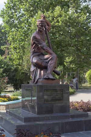 saz: Monument to the famous Crimean Tatar songwriter Ashik Omer in Evpatoria, Republic of Crimea, Russia