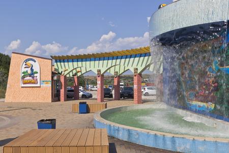 Waterfall with a scheme at the entrance to the water park Tiki-Tak resort settlement Dzhemete, Anapa, Krasnodar region, Russia