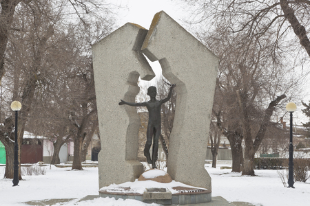 Evpatoria, Crimea, Russia - February 28, 2018: Monument to the victims of Chernobyl in the Komsomol park of Evpatoria, Crimea Editorial