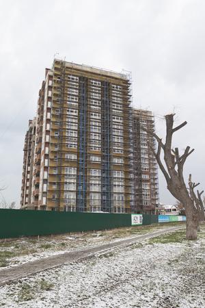 Anapa, Krasnodar region, Russia - March 2, 2018: Construction of a multi-storey building on Pioneer Avenue in the resort village of Jemit, Anapa