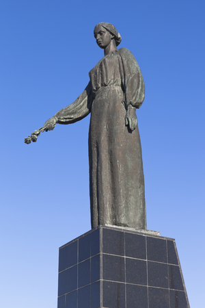 Evpatoria, Crimea, Russia - July 3, 2018: Monument of Grieving Mother at the Red Hill Memorial Complex against a blue sky in the city of Evpatoria, Crimea