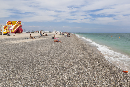 Evpatoria, Crimea, Russia - July 5, 2018: The new beach of the resort town of Evpatoria, Crimea Editorial