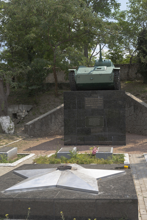 Bakhchisaray, Crimea, Russia - July 22, 2019: Eternal Flame and T-70 tank at the fraternal cemetery of Soviet soldiers in the territory of the Bakhchisarai Khan Palace, Crimea