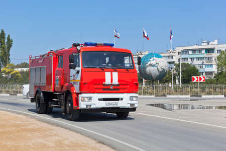 Chernomorskoe, Crimea, Russia - July 21, 2020: A fire truck rushes to the call along Energetikov street in the village of Chernomorskoe, Crimea