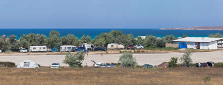 Olenevka, Chernomorsky District, Crimea, Russia - July 21, 2020: Panoramic view of the Sunset campsite in the village of Olenevka, Chernomorsky District, Crimea