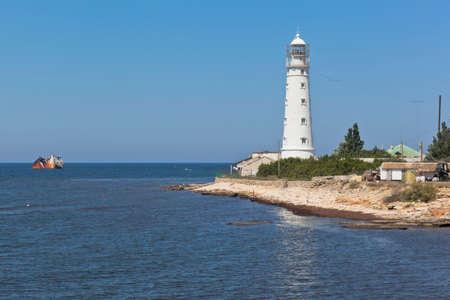 Tarkhankut lighthouse and dry-cargo ship Ibragim Yakim stranded by a storm, Crimea, Russia