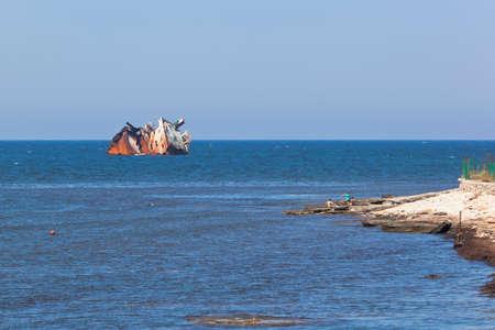 Remains of the dry-cargo ship Ibragim Yakim stranded near Cape Tarkhankut, Crimea, Russia Stock Photo