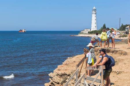 Olenevka, Chernomorsky District, Crimea, Russia - July 21, 2020: Tourists expect a boat trip along the coast of Cape Tarkhankut, Crimea