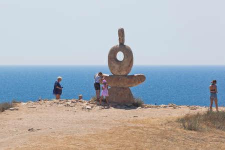 Olenevka, Chernomorsky District, Crimea, Russia - July 21, 2020: Sculpture The Thinker Heart of Tarkhankut on the White Rock of Cape Tarkhankut, Crimea Editorial
