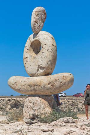 Chernomorsky district, Crimea, Russia - July 21, 2020: Sculpture The Thinker on the White Rock of Cape Tarkhankut, Crimea