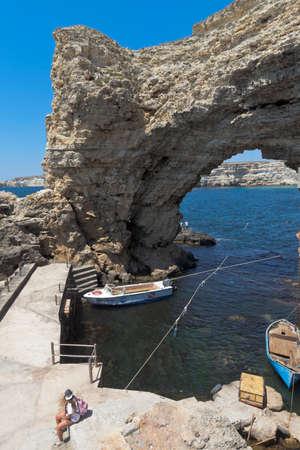 Chernomorsky District, Crimea, Russia - July 21, 2020: Arch of the Big Atlesh Cape on the Tarkhankut Peninsula, Crimea
