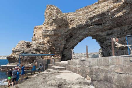 Chernomorsky District, Crimea, Russia - July 21, 2020: Arch of Cape Big Atlesh - the main symbol of Tarkhankut, Crimea