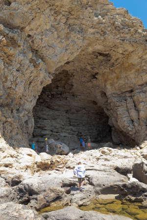 Chernomorsky District, Crimea, Russia - July 21, 2020: Grotto at Cape Big Atlesh of Tarkhankut Peninsula, Crimea