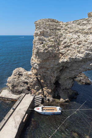 Chernomorsky District, Crimea, Russia - July 21, 2020: The pier at the arch of the Big Atlesh on the Tarkhankut Peninsula, Crimea Editorial