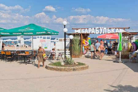 Zaozyornoye, Evpatoria, Crimea, Russia - July 21, 2020: Entrance to the public village beach Barabulka in Zaozyorny, Evpatoria, Crimea Editorial