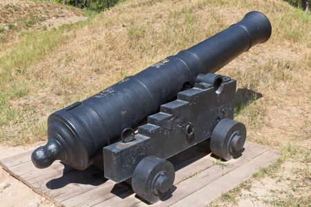 Sevastopol, Crimea, Russia - July 27, 2020: English 24-pounder cannon with the mark of George III, cast for the East India Company, in the memorial complex Malakhov Kurgan in the city of Sevastopol, Crimea Editorial