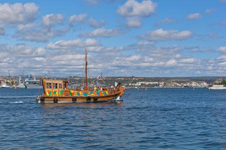 Sevastopol, Crimea, Russia - July 27, 2020: Stylized yacht Eva of the shipping company Rose of the Winds in the Sevastopol Bay, Crimea