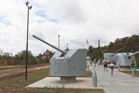 Sevastopol, Crimea, Russia - July 28, 2020: Soviet naval guns of the Great Patriotic War with an 85-mm universal gun 90-K in the foreground at the memorial complex Sapun-Gora in the hero city of Sevastopol, Crimea