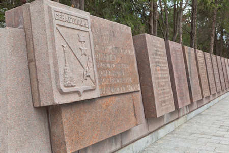 Sevastopol, Crimea, Russia - July 28, 2020: Memorial wall with the names of 118 formations and units awarded for the liberation of the city of Sevastopol, the honorary title of Sevastopol in the memorial complex Sapun Gora in the hero city of Sevastopol,  Editorial