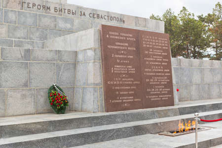 Sevastopol, Crimea, Russia - July 28, 2020: Eternal Flame at the Obelisk of Glory to the Soldiers - Liberators on Sapun Mountain in the Hero City Sevastopol, Crimea Editorial