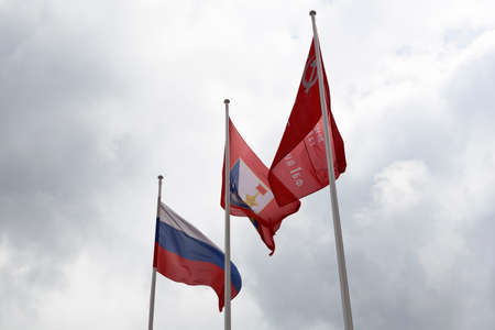 Flags of Russia, the hero-city of Sevastopol and the banner of Victory against a cloudy sky Stock Photo