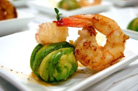 Avocado ball stuffed with pink shrimp fried basmati rice Stock Photo
