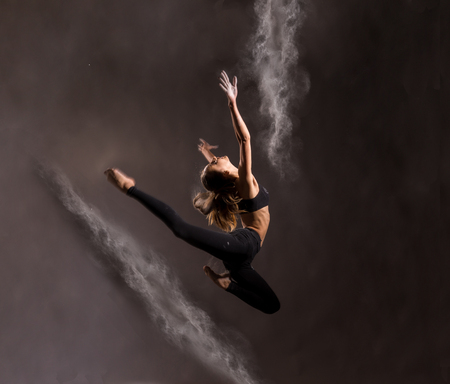 Girl dancing with a flour, jumping, zero gravity