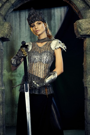 girl in armor with a sword and a crown