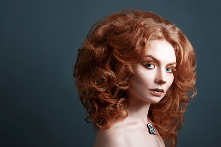 girl with red hair, creative makeup and eyelashes beautiful hairstyle 写真素材