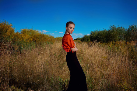 girl in a red blouse stands in the field 写真素材 - 117282162