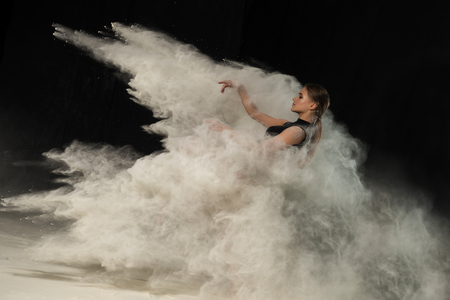 Girl dancing with flour on black background one person 写真素材 - 123044701
