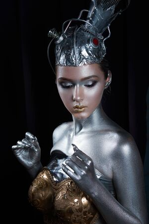 young, beautiful girl with silver skin in a crown and gold armor