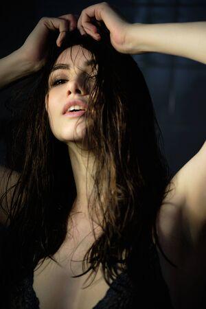 portrait of sexy beautiful young woman having fun relaxing in bathtub