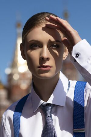 A young beautiful girl dressed in a mens suit poses Stock fotó - 150292253