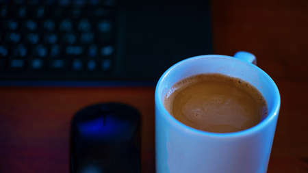 selective focus of instant coffee in white glass on desktop