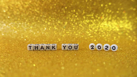 letters cubes thank you 2020 yellow glitter background Christmas new year