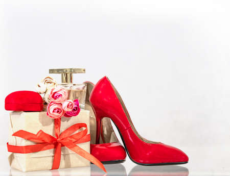 Baner gift for the holiday Valentines Day. perfume, flowers, jewelry box, red shoes. Love and gifts concept