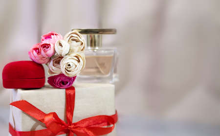 Baner gift for the holiday Valentines Day. perfume, flowers, jewelry box. Love and gifts concept