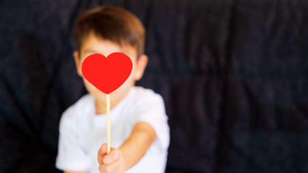 Little Boy and red hearts. Valentines Day concept. Selective focus
