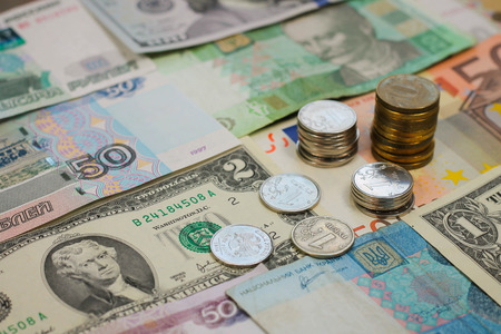 international money: Money from different countries  dollars, euros, hryvnia, rubles  Stock Photo