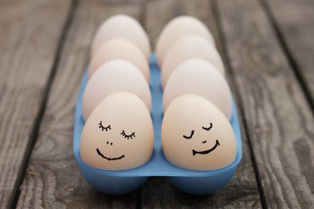 2 objects: Happy couple in love  Eggs