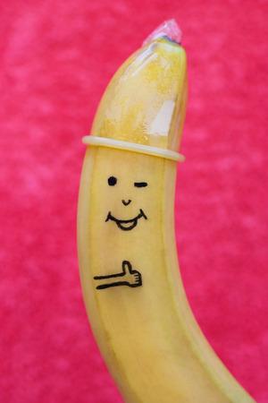 Banana with condom  版權商用圖片