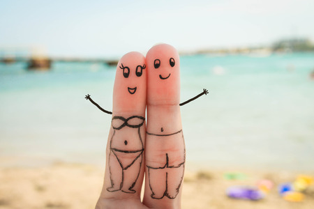 Happy couple have a rest on the beach in bathing suits  photo