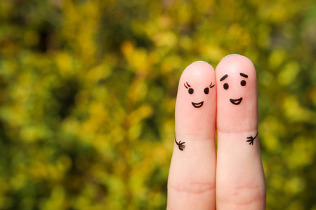 Finger art of a Happy couple. A man and a woman hug on the background of yellow leaves Banco de Imagens