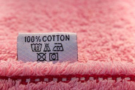 dry cleaned: Label 100 percent cotton on pink towel